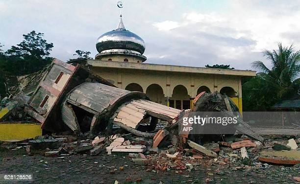 TOPSHOT A collapsed mosque minaret is seen after a 65magnitude earthquake struck the town of Pidie Indonesia's Aceh province in northern Sumatra on...