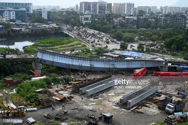 Collapsed portion of an under construction bridge is pictured in Mumbai on September 17, 2021.