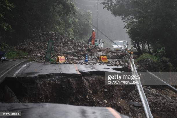 """Collapsed road caused by heavy rain in Kuma, Kumamoto prefecture on July 7, 2020. - Emergency services in western Japan were """"racing against time"""" to..."""