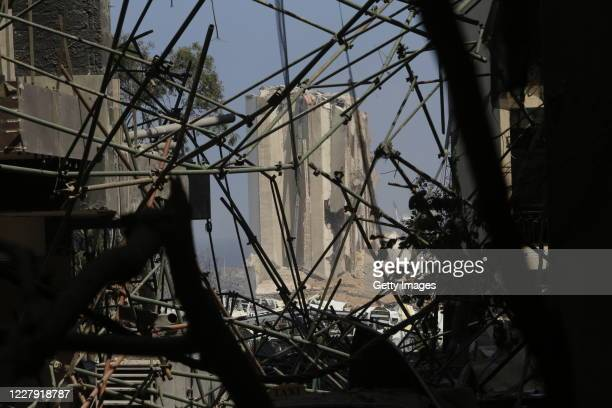 Collapsed scaffolding lies before a smoldering building at the citys port, destroyed by an explosion a day earlier, on August 5, 2020 in Beirut,...