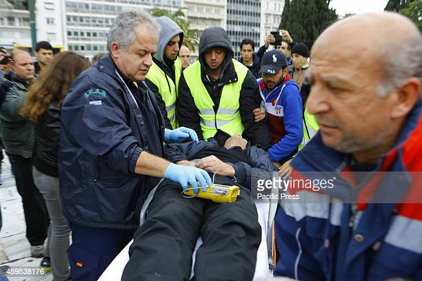 Collapsed Syrian refugee is carried on a stretcher to the waiting ambulance. Some of the Syrian refugees who have fled from the Syrian civil war to...