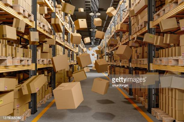 collapsing and flying cardboard boxes in the warehouse - pallet industrial equipment stock pictures, royalty-free photos & images