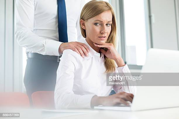 Colleague harassing businesswoman