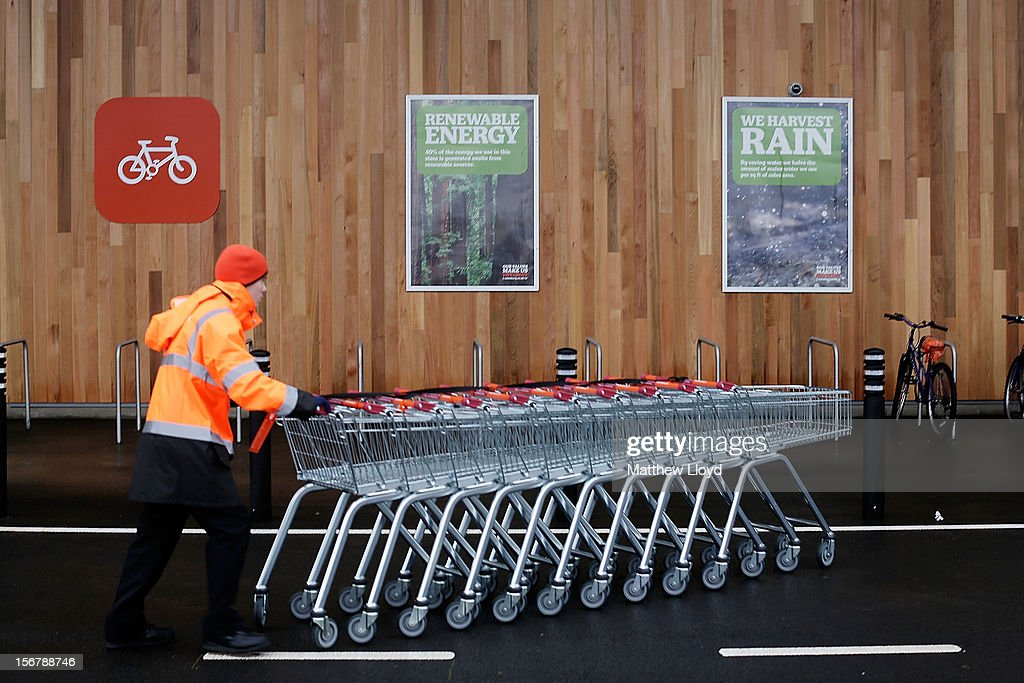 A colleague moves trolleys in the car park of Sainsbury's new Kings Lynn supermarket, one of the retailer's most energy efficient stores on 21 November in Kings Lynn, England. The 72,000sq ft store has created over 400 new jobs for local people and opens on the day Sainsbury's reveals findings that shopping lists, better meal planning and rising expectations signal new fashioned values of post-crunch shoppers.