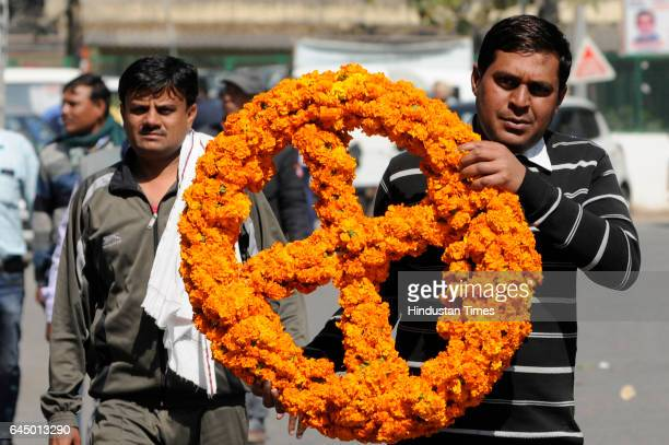 A colleague of Hari Om carrying a wreath for his coffin who lost his life when a cylinder blasted in Vikaspuri early this morning at the Mortuary at...
