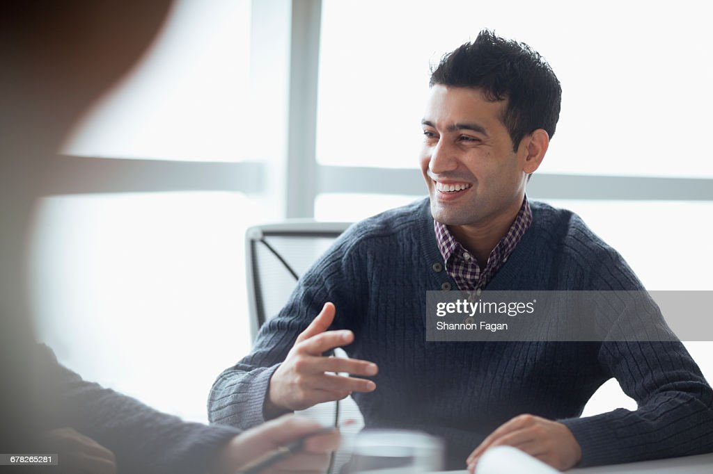Colleague talking at meeting in company office : Stock Photo