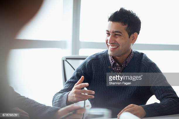 Colleague talking at meeting in company office