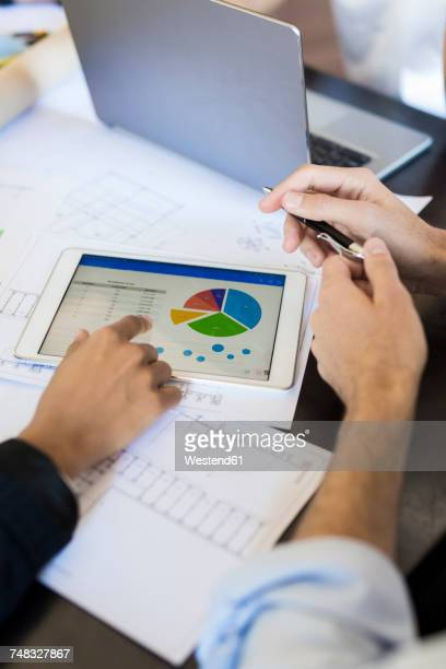 Colleagues analyzing data in office