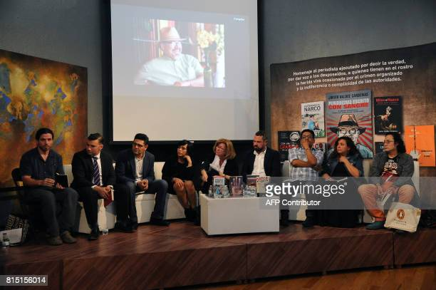 Colleagues and friends of slain Mexican journalist Javier Valdez attend a tribute to the reporter in Mexico City on July 15 2017 Valdez journalist...