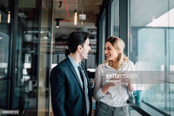 colleagues and friends - flirting stock pictures, royalty-free photos & images