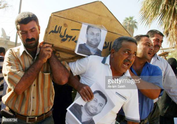 Colleagues and relatives of Reuters TV soundman Waleed Khaled aged 36 carry his casket and picture as they take part in his funeral on August 29 2005...