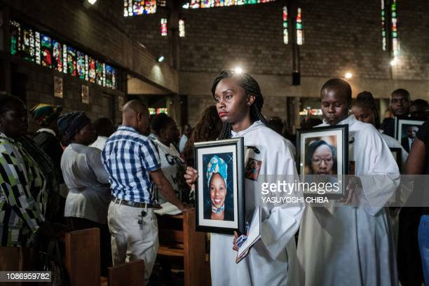 TOPSHOT Colleagues and relatives of six staff of the Dusit hotel who were found dead following last week attack leave with their portraits during the...