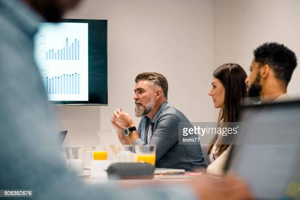 Colleagues at a small conference room