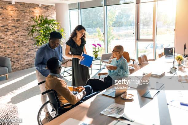 colleagues at business meeting in conference room - organised group stock pictures, royalty-free photos & images
