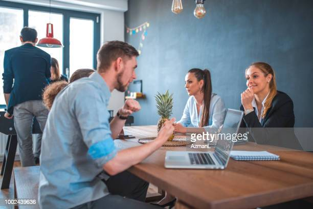 Colleagues at cafeteria during break in office