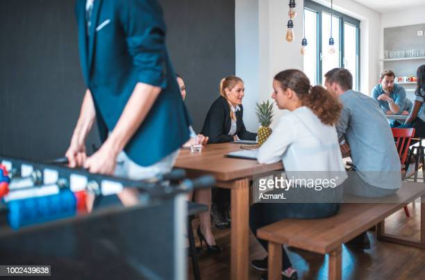 Colleagues at cafeteria in office