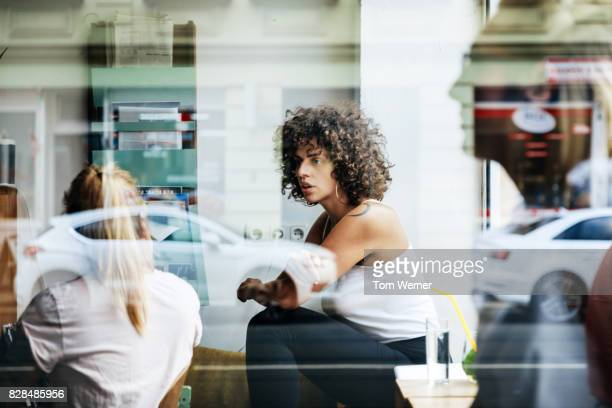 colleagues brainstorming in cafe together - women in transparent clothing stock photos and pictures