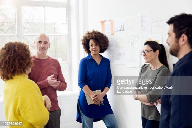 colleagues brainstorming in modern office - vanguardians stock pictures, royalty-free photos & images