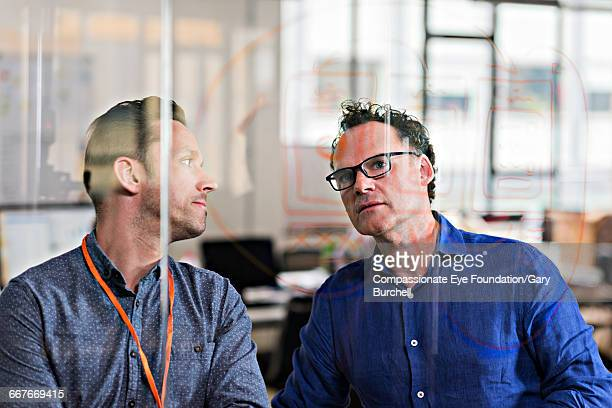 colleagues brainstorming in tech start-up office - cef do not delete stock pictures, royalty-free photos & images