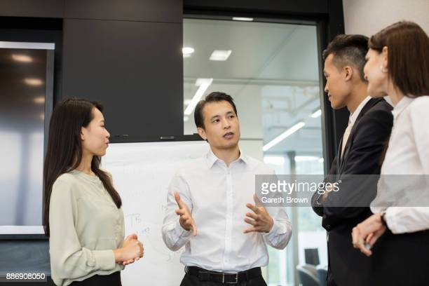 colleagues brainstorming - visual china group stock pictures, royalty-free photos & images