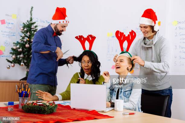 Colleagues celebrating Christmas in office during working hours
