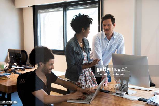 Colleagues chatting in office