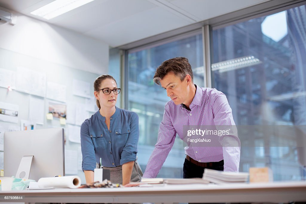 Colleagues collaborating in design studio office : Stock Photo