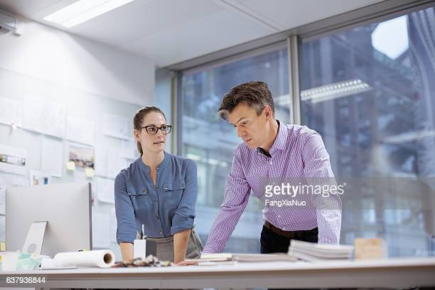 colleagues collaborating in design studio office - copyright stock photos and pictures