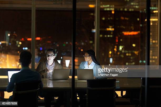 colleagues collaborating in office at night - visual china group stock pictures, royalty-free photos & images