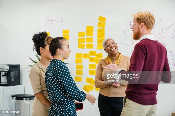 colleagues coming up with ideas - meeting stock pictures, royalty-free photos & images