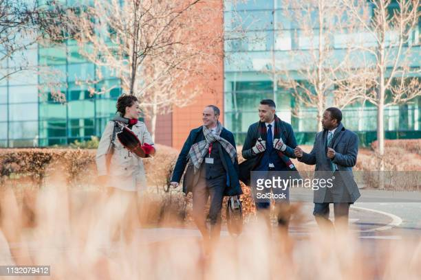 colleagues commuting to work - business community stock pictures, royalty-free photos & images