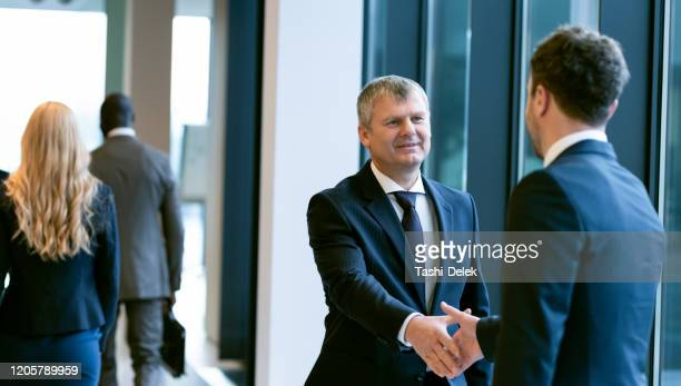 colleagues consulting in a looby - ambassador stock pictures, royalty-free photos & images