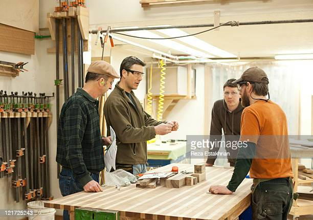 Colleagues discuss woodworking project