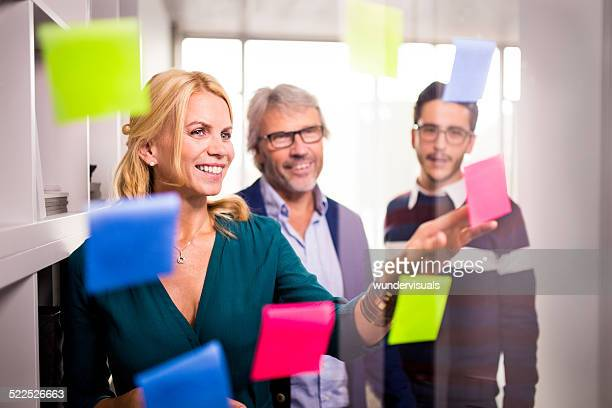 Colleagues Discussing Business Ideas With Sticky Notes