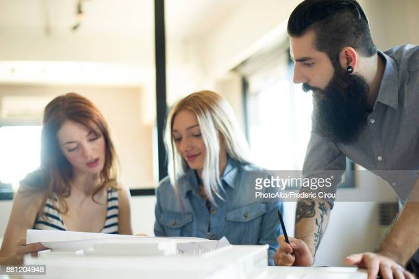 Colleagues discussing project in casual office