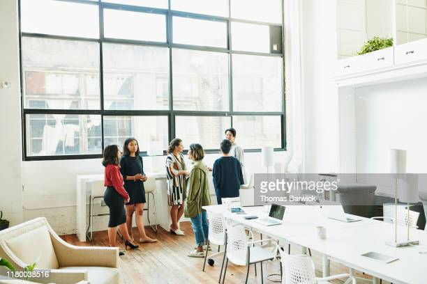 colleagues discussing project in coworking office space - philippine independence day stock pictures, royalty-free photos & images