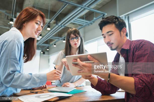 colleagues discussing project in modern office - flexibility stock pictures, royalty-free photos & images