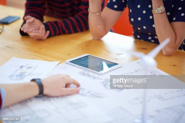 Colleagues discussing project on a tablet computer