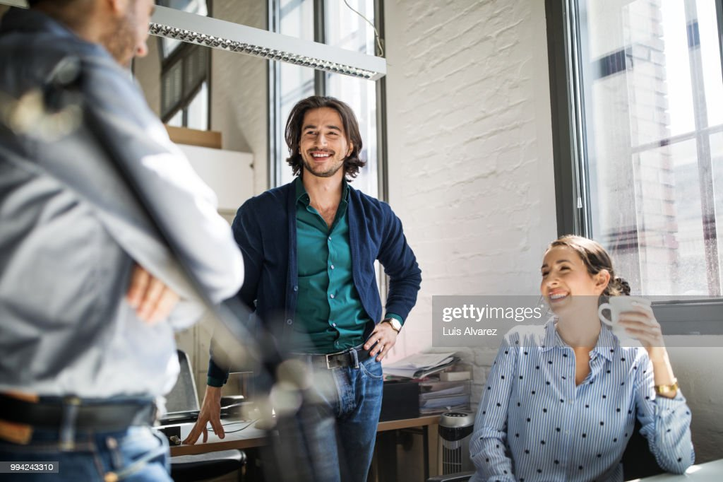 Colleagues discussing strategy during meeting : Stock Photo