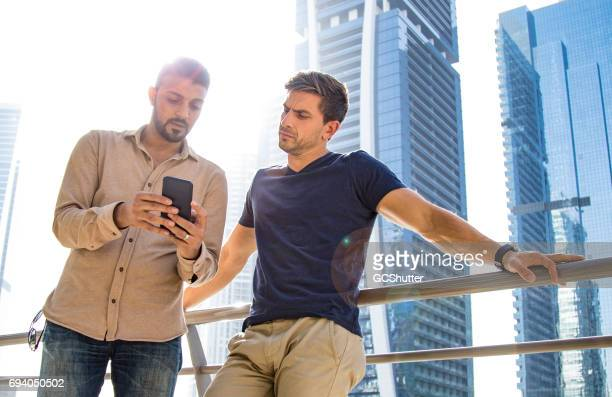 Colleagues discussing work email outside their working hours