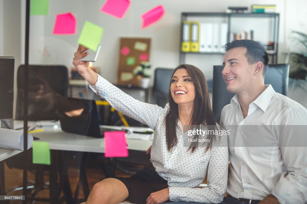 Colleagues doing a selfie : Stock Photo