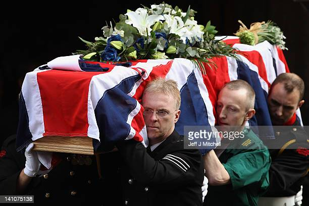 Colleagues from the emergency services carry the coffin of PC Rathband from St Nicholas Cathedral following a memorial service on March 10 2012 in...