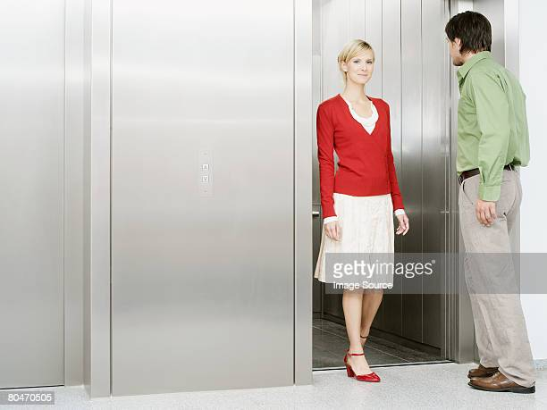 Colleagues getting in a lift