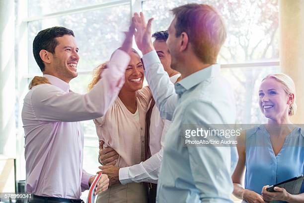 colleagues giving each other high-five - 35 39 jahre stock-fotos und bilder