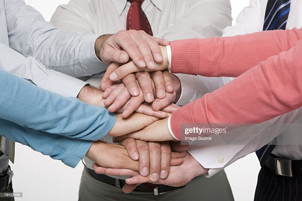 Colleagues hands on top of each others : Stock Photo
