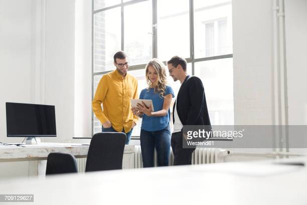 Colleagues having a meeting in office