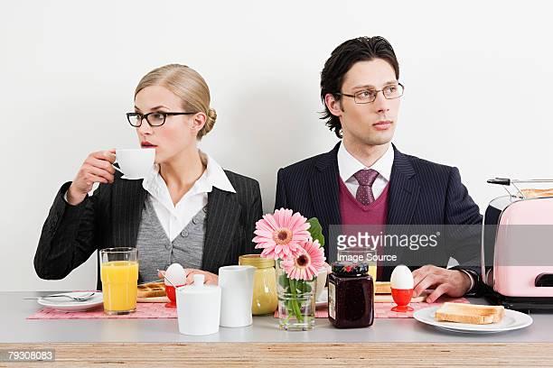 Colleagues having breakfast