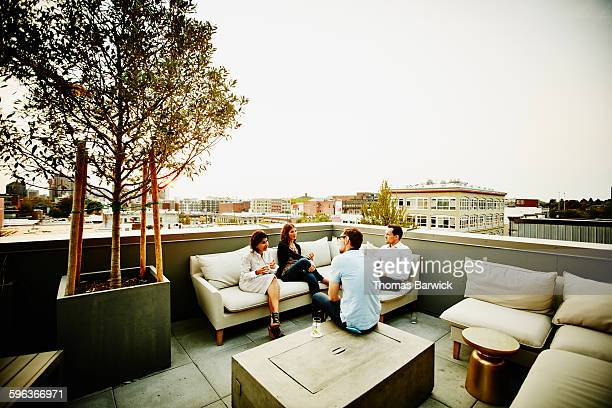 Colleagues having drinks on office terrace