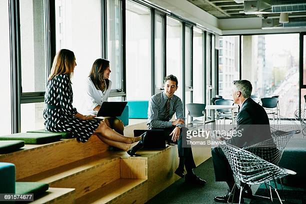Colleagues having informal meeting in office