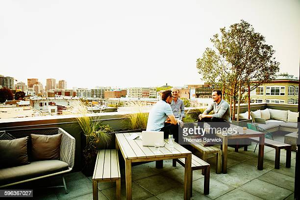 Colleagues having meeting on office terrace